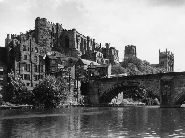 Durham Castle (now part of Durham Univerity) with the fantastic Norman Cathedral in the background. Framwellgate Bridge is in the foreground Date: 1950s