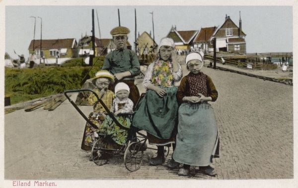 A group of Dutch children in traditional costume, including clogs