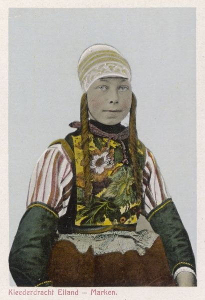A Dutch girl wearing traditional costume, including a lace cap and floral vest