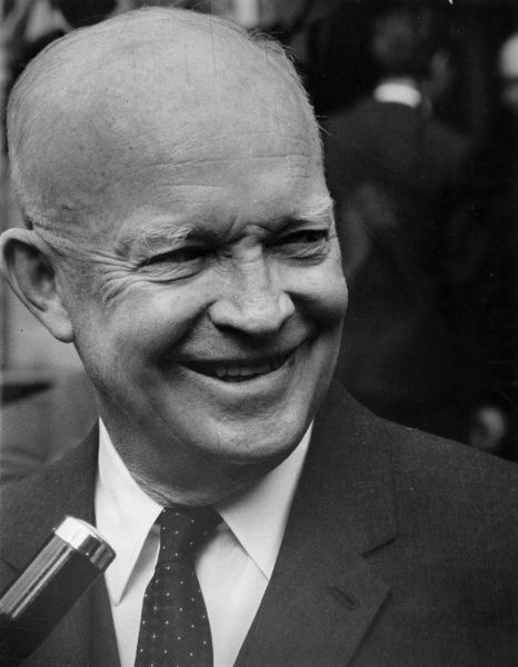 DWIGHT D EISENHOWER American soldier and 34th US President (1953-61) in front of a microphone