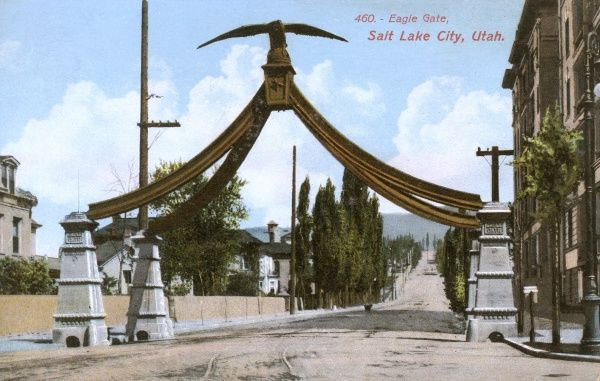 The Eagle Gate Monument at the intersection of State Street at South Temple, adjacent to Temple Square, in Salt Lake City, Utah, USA. Date: circa 1910s