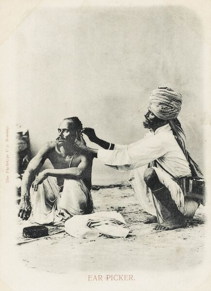 A wonderful postcard depicting an Indian ear picker and client in Bombay (Mumbai)