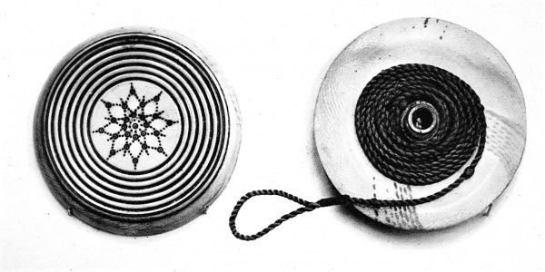Photograph showing the two halves of a yo-yo from the Napoleonic period, made of ivory, with a brass core, 1932