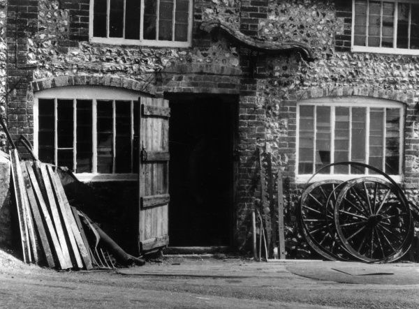 The old Farrier's Shop at East Dean, Sussex, England. Above the door can be seen the last yoke used by oxen in Sussex. Date: 1930s