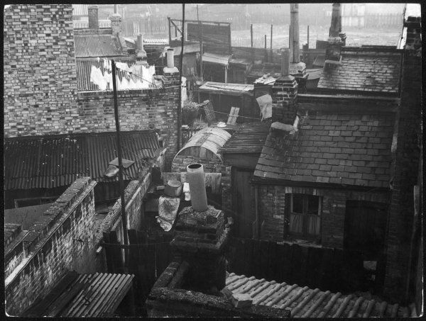 Crowded back-to-back working class terraced housing in the East End of London, condemned for demolition