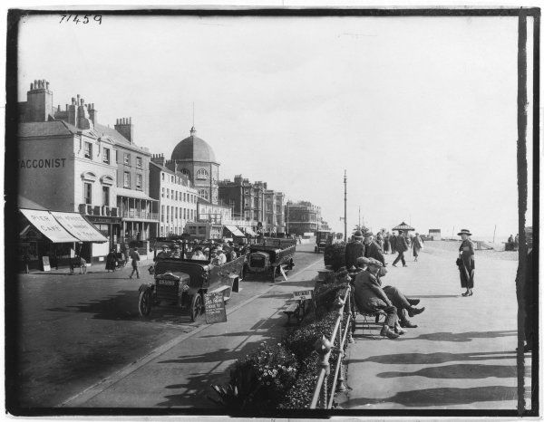 View of the East Parade at Worthing, West Sussex, with holidaymakers and charabancs