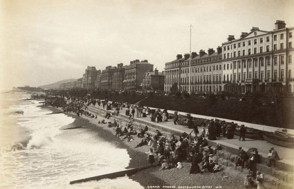Holidaymakers on the Grand Parade at Eastbourne, Sussex. Date: circa 1890