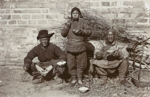 A lovely photograph of three Chinese workers (of very different ages) having their rice for lunch. The padded clothing attests to either the season or the type of labout they were occupied in
