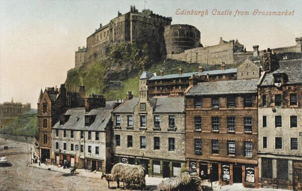 A view of Edinburgh Castle from the Grassmarket, with carts laden high with grass in the foreground