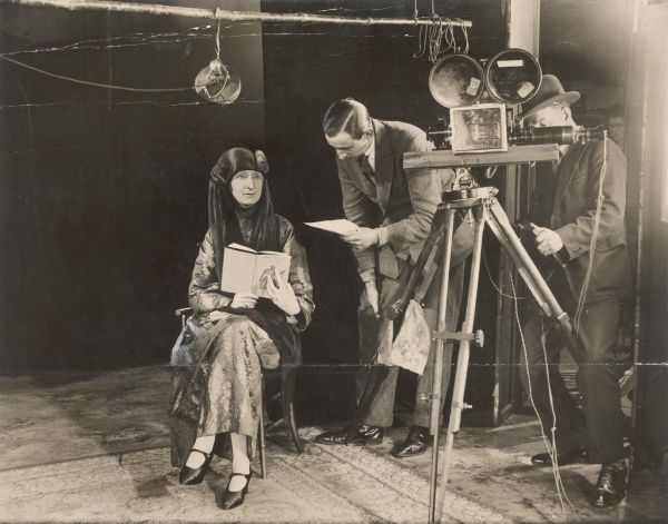 EDITH SITWELL Writer, reading from her 'Rustic Elegies', being filmed while her voice is recorded in synch, in 1927