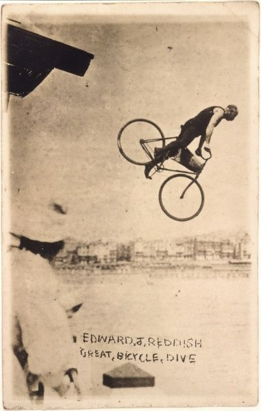 Edward J Reddish performs his Great Bicycle Dive off the pier at Worthing, Sussex
