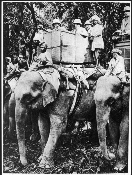 EDWARD VIII As Prince of Wales, travelling by elephant in Nepal
