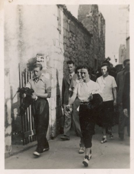 EDWARD VIII and Mrs Simpson, with the King's private detective and Mrs Fitzgerald in the rear. Taken at Rab in Yugolsavia during the King's holiday in September 1936