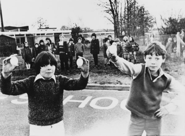 Two boys from the 'Keep Hatch School' at Wokingham, Berkshire, hold some of the eggs which fell out of a clear sky in December 1974