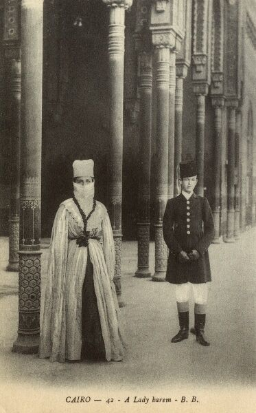Egypt - Cairo - A Lady of the Harem with escort Date: circa 1910s