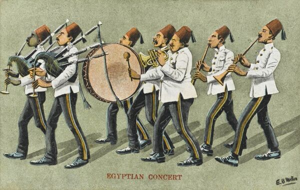 An Egyptian military band, with bagpipe players, drummer, a cornet player and Egyptian horn players. All the men wear a uniform of dark trousers, white jackets and red fez hats