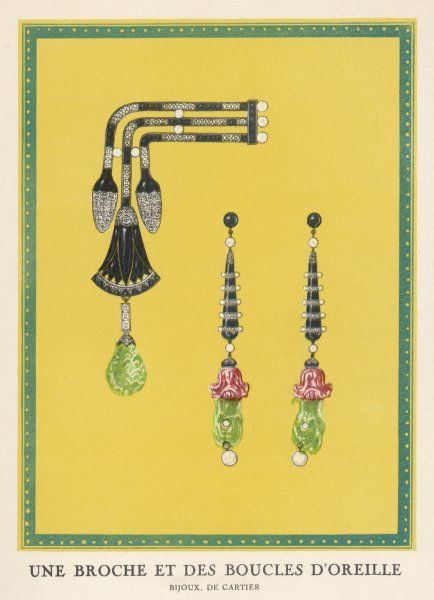 Egyptian-style jewellery by Cartier - a brooch and earrings