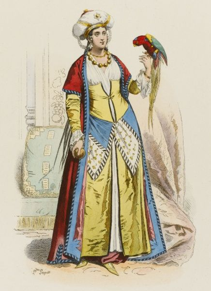 A woman of Cairo with her pet bird perched on her hand