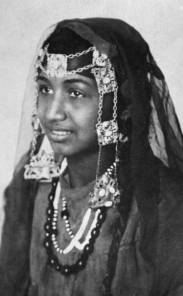 A mohammedan muslim woman in her headdress, probably in Egypt or another North African country. Date: 1930s