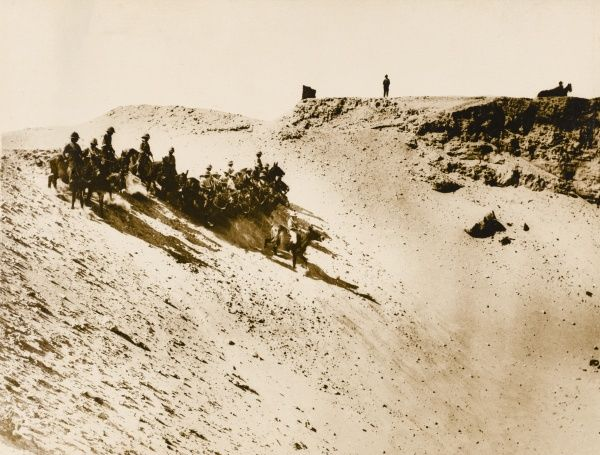 The 44th Squadron at an Egyptian remount depot near the coast. Exercising the mules and going down the steep sides of a sand-covered disused quarry
