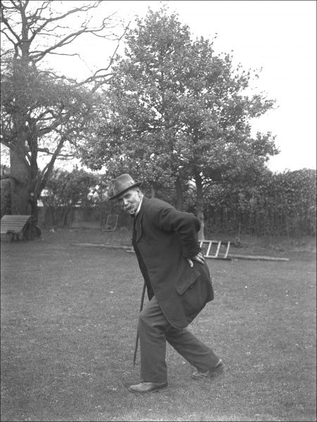 An elderly man hobbling across a lawn, somewhere in Devon. Date: circa 1916