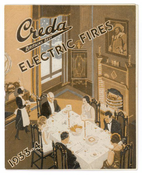 A uniformed maid carries a flaming plum pudding into the dining room where the family sit in formal dress, warmed by the glow of a Creda electric fire. Date: 1933-4
