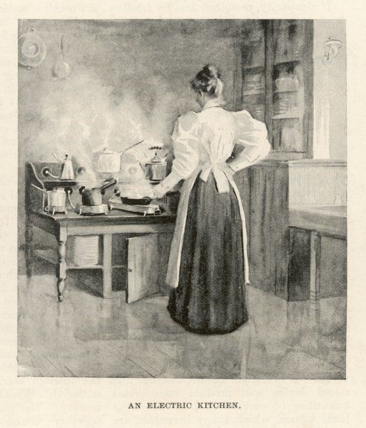 A woman cooking in an electric kitchen