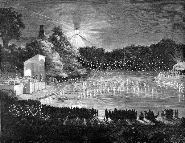 Engraving showing a large crowd of Victorian holiday-makers enjoying the illumination of the Alexandra Palace lakes, London, by electric light, 1880. Date: 21 August 1880