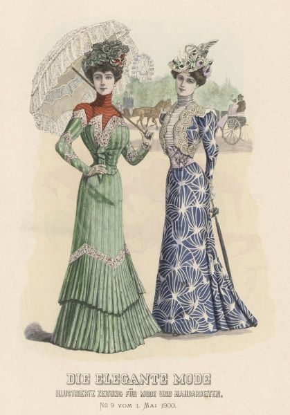 A lady in a green pleated dress holding a lacy parasol with her companion who wears a dress with a bold blue design; a big wheel is in the background