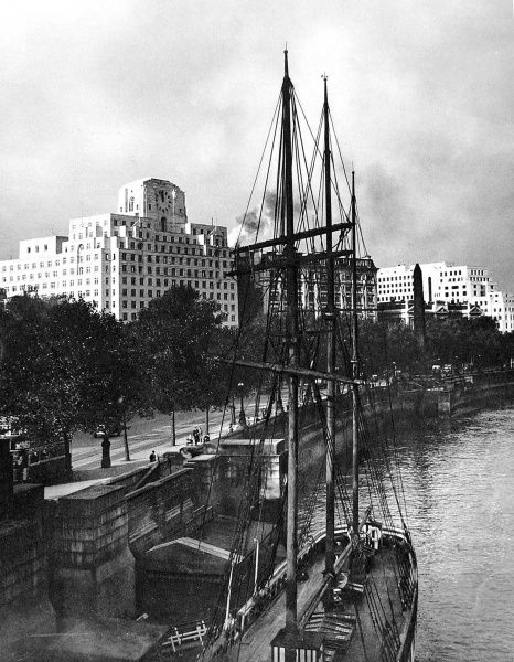 Photograph showing the Embankment, on the North bank of the River Thames, London, 1932. In the foreground is the sailing-ship 'Friendship', in the middle distance 'Cleopatra's Needle' and in the background the Shell-Mex building