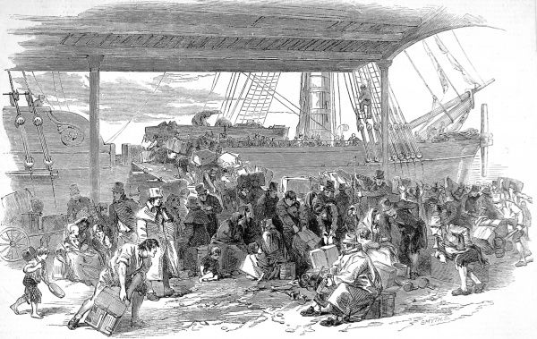 Engraving showing a bustling dock yard scene as emigrants, with trunks and boxes, line up to board their ship at Waterloo Docks, Liverpool, 1850. In 1848 153,902 emigrants travelled steerage to the USA and British colonies from Liverpool. Only 4