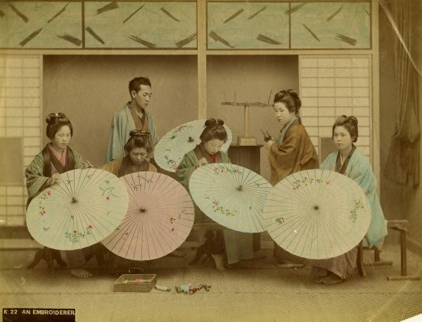 A team of Japanese embroiderers working on decorative parasols
