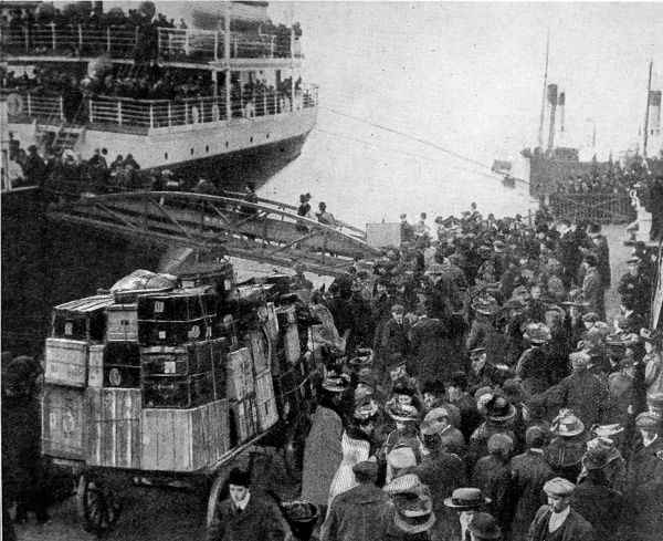 Photograph showing British emigrants boarding the Allan Liner 'Virginian' at Liverpool Dock, bound for Canada, 1909