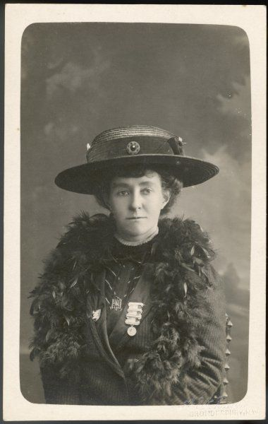 EMILY DAVISON Died after throwing herself in front of the King's horse at the Derby in June 1913, She is wearing a 'prisoner's brooch' & another medal