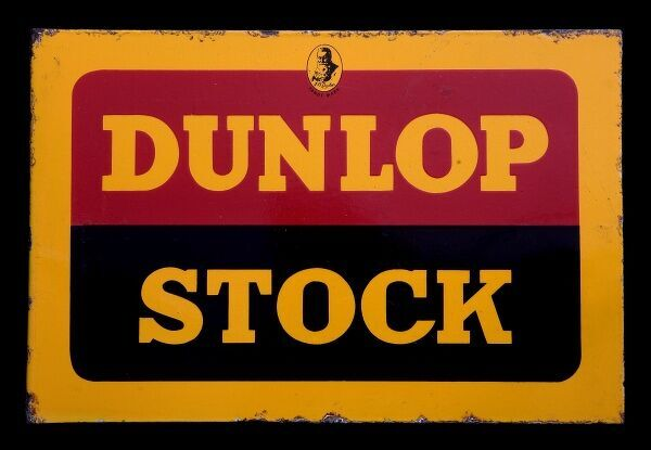 A bold enamel sign for Dunlop stock in red, yellow and black. *EDITORIAL USE ONLY*