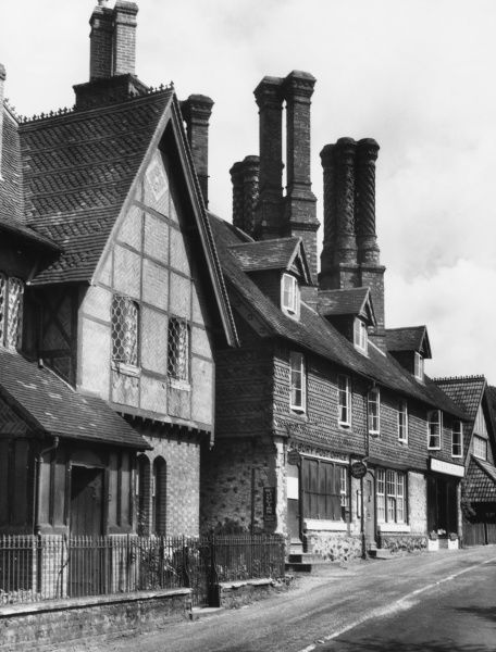 A glimpse of Albury, a Surrey hamlet with a delightful valley. Note the fine, intricate details on the various chimney stacks