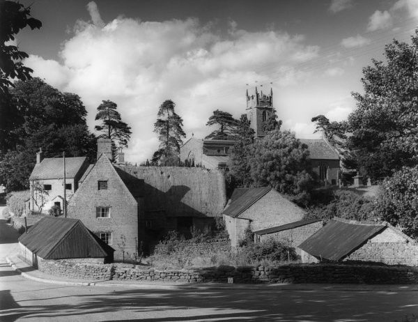 The church and a pretty part of the hamlet of Balscote, Oxfordshire, England. Date: early 1960s