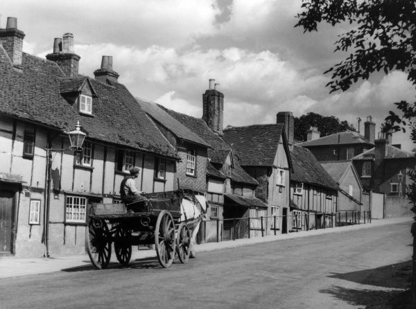 A horse and cart on Castle Street, Berkhampstead, Hertfordshire, England. Date: 1950s