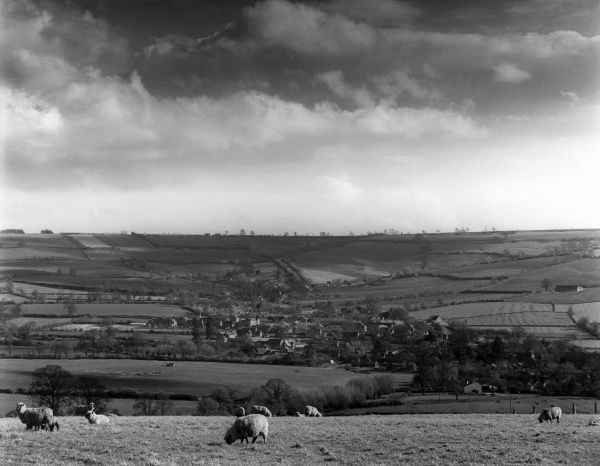 A distant view of Long Compton village, from Harrow Hill, Warwickshire, England. Date: early 1960s