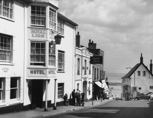 The steep High Street, with the 'Royal Lion' and 'New' Inn, at Lyme Regis, Dorset, England