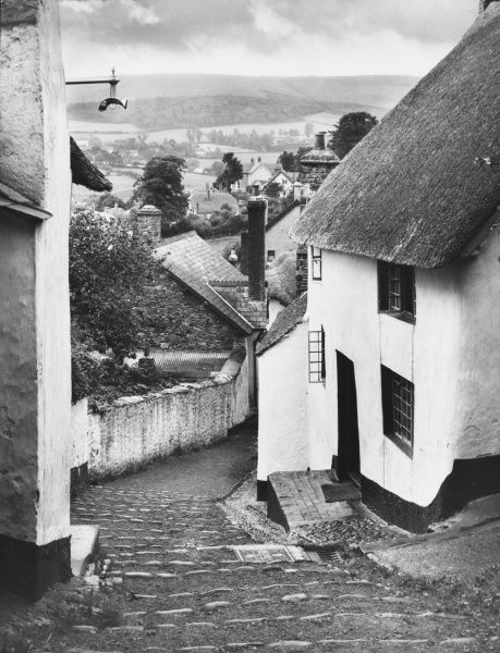 Church Steps, Minehead, Somerset, a steep and narrow way up to the 14th century church of St. Michael's-on-the -hill. Thatched roofs and tall chimneys feature in this town