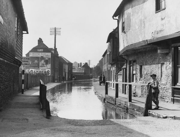 Ospinge, a small village in Kent, England, notable for containing a stream flowing down the road, called, most appropriately, 'Water Lane&#39