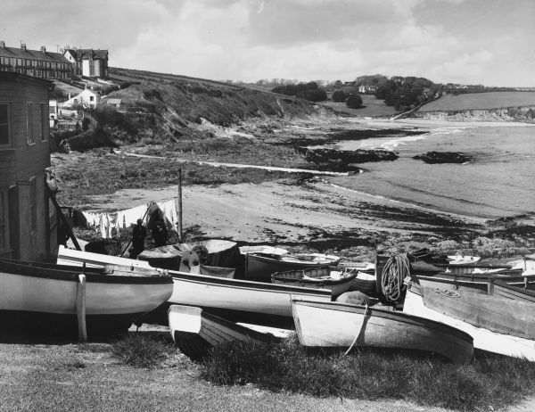 The beach at Porthscatho, a typical small Cornish fishing hamlet, on the south coast of Cornwall, England. Date: circa 1950