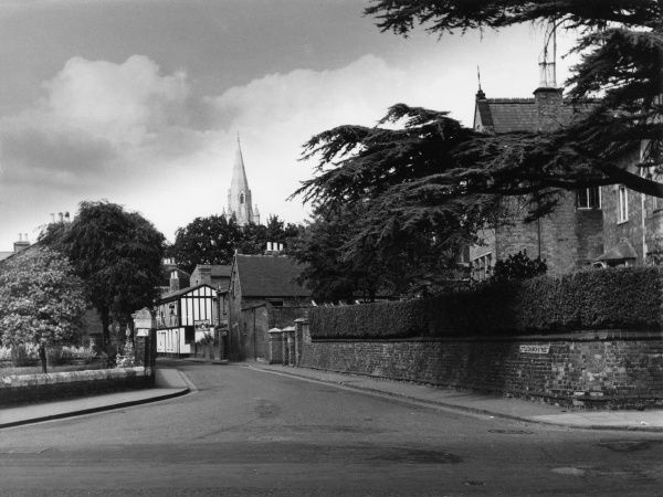 Little Church Street, Rugby, Warwickshire, England, with the spire of St. Andrew's church in the background. Date: 1950s