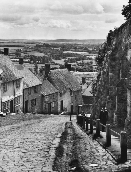 Looking down Gold Hill, Shaftesbury, Dorset's highest town. On the right is the Abbey Wall and part of the Old Town Wall. King Canute died here on 12 November 1035