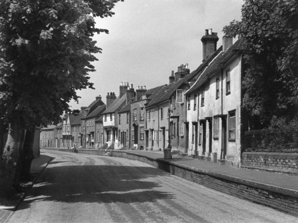 The ancient Fishpool Street, St. Albans, Hertfordshire, England, with its quaint raised pavement. Date: 1950s