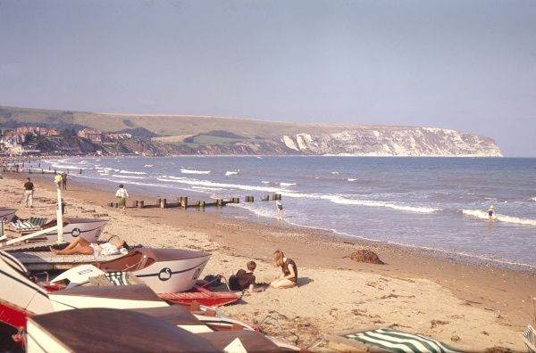 Holidaymakers relaxing on Swanage beach, Dorset, England. Date: 1966