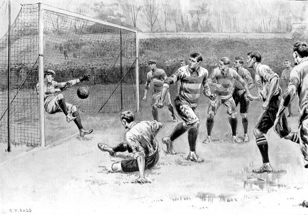 Illustration of the England vs. Scotland Football Match on 30th March 1901, showing Blackburn of England (front left of image, on floor) scoring the first goal of the game. The Scottish goalkeeper, Rennie, despite his diving effort was unable to save