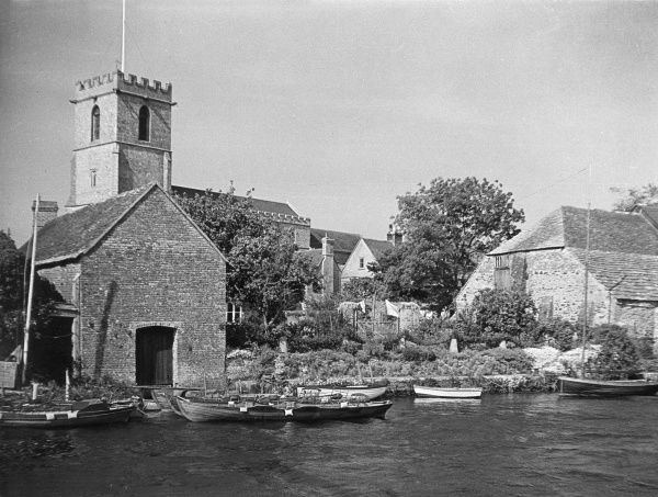 Wareham, Dorset, England, with its Norman church, on the banks of the River Frome. Date: 1960s