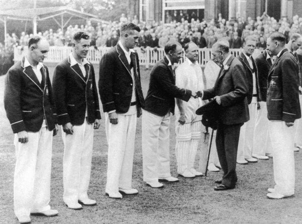 The King present at the second England versus Australia test match. King George V with the Australian team, shaking hands with Bradman, the famous Australian batsman. England beat Australia in the Second Test Match at Lord's on 25th June by an innings
